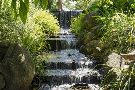 Artificial waterfall in landscaped botanic gardens