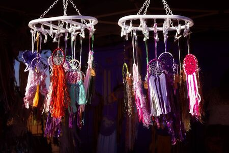 A selection of hand made dream catchers on display for sale at a market stall