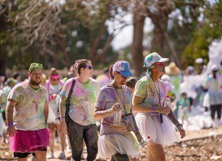 Mackay, Queensland, Australia - November 24th 2019: Unidentified participants in 5 K Colour Frenzy Fun Run outdoors in a public park