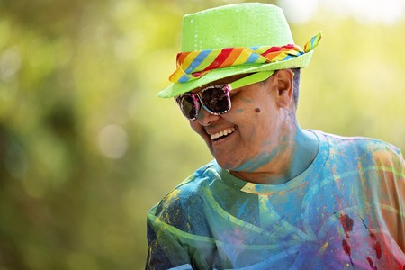 Mackay, Queensland, Australia - November 24th 2019: Unidentified man smiling as he participates in the 5 K Colour Frenzy Fun Run outdoors in a public park