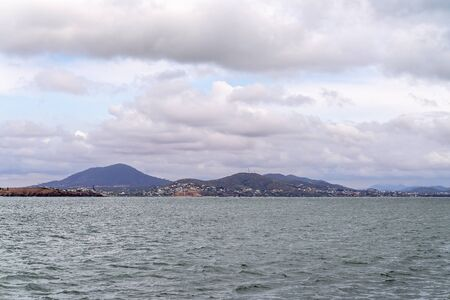 The small coastal town of Yeppoon on the Capricon Coast of Australia as seen from the ocean on a cloudy and windy day