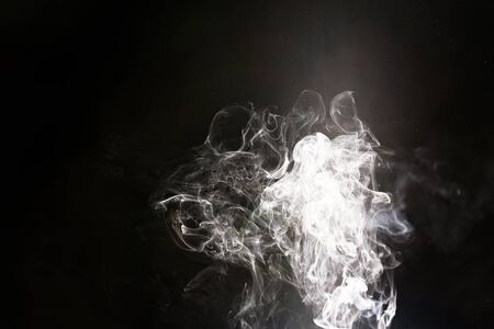 Creating smoke from burning paper using only the intense column of natural light streaming down through Australia's Capricorn Caves during the rare summer solstice Banco de Imagens