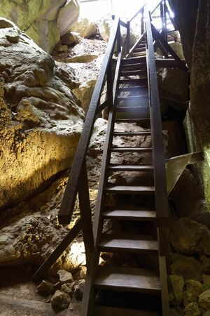 Steps leading upwards inside Australia's bat ecotourism Capricorn Caves, where the light is extremely low and photography difficult