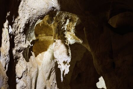 A cavern inside Australia's bat ecotourism Capricorn Caves, where the light is extremely low and photography difficult