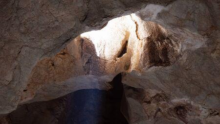 Rare summer solstice showing a sunbeam of light entering through Australia's bat ecotourism Capricorn Caves, occurs in December