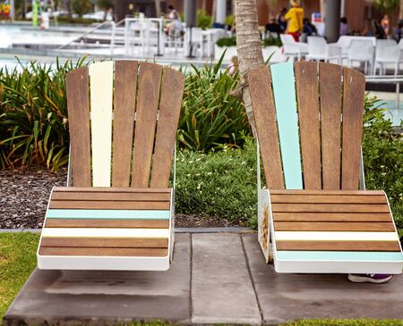 Capricorn Coast Australia - Two wooden deck chairs in the sun at a lagoon for guests to relax