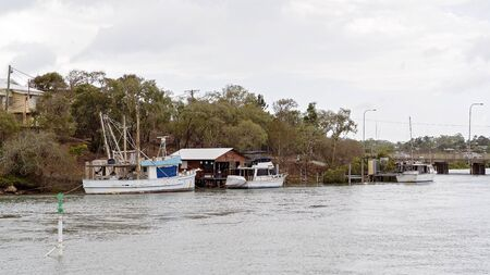Capricorn Coast Australia - Fishing and recreational boats moored in a creek at private jetties Reklamní fotografie