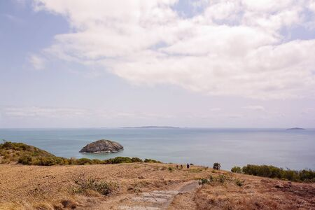 People bushwalking on Bluff Point on the coast of the Coral Sea, at Capricorn Coast of Australia