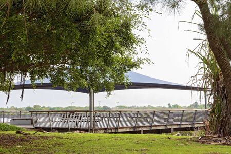 A covered shade area along the esplanade or walkway on the river bank for public recreation Reklamní fotografie