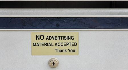 Close up of a mail box with warning