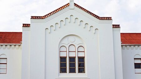 Exterior of an old church building with tiled roof