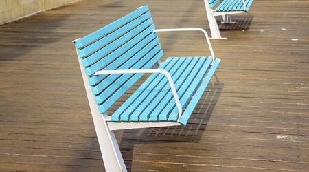 Blue and white timber and steel chair on a wooden deck