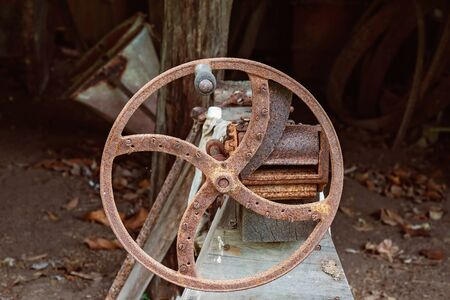 An old rusted chaff cutter which would have been used for chopping hay to feed animals by early settlers
