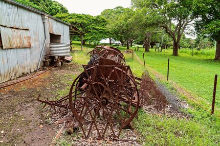 Old rusted farming machinery once used by the early settlers in Australia to till the soil Stock Photo