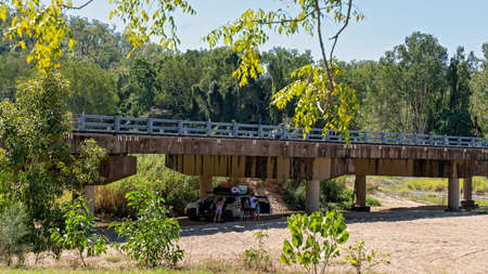 Mackay, Queensland, Australia - May 2020: A family in their car having a picnic in the shade under a bridge on a hot summer day