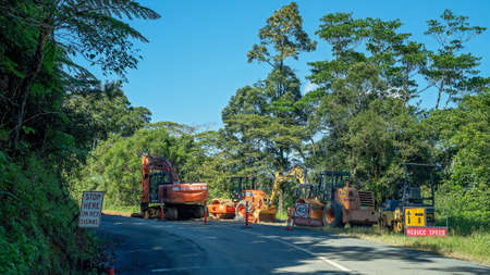Mackay, Queensland, Australia - May 2020: Roadwork repairs on a mountain road in a national park