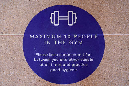 Townsville, Queensland, Australia - June 2020: Signage stating maximum number of people allowed in the gym at a resort hotel Editorial