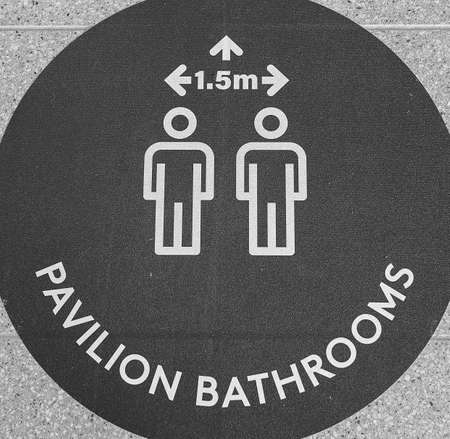 Townsville, Queensland, Australia - June 2020: Signage stating minimum distance in bathrooms during Covid-19 social distancing restrictions