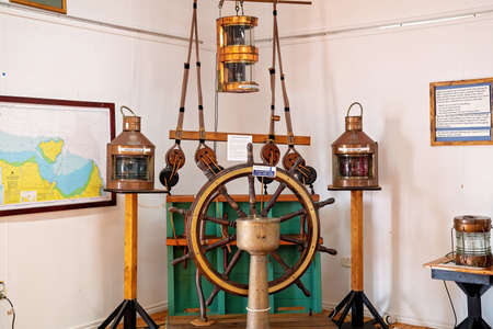 Townsville, Queensland, Australia - June 2020: Lighting objects and steering wheel used in navigation in a bygone era
