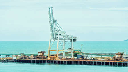 Townsville, Queensland, Australia - June 2020: Industrial wharf with ship loading facilities for import and export of goods and commodities