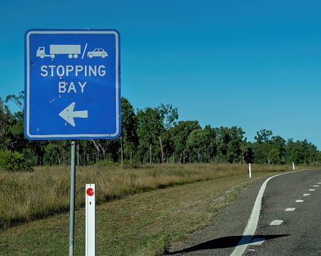 Stopping bay sign with truck and car icons on Australian bush highway