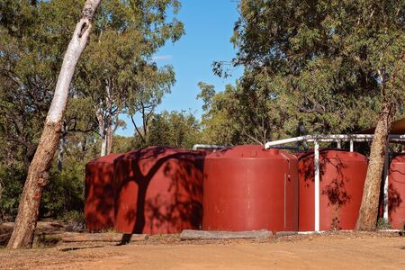 Large water tanks at an Australian outback tourist resort in a volcanic national park