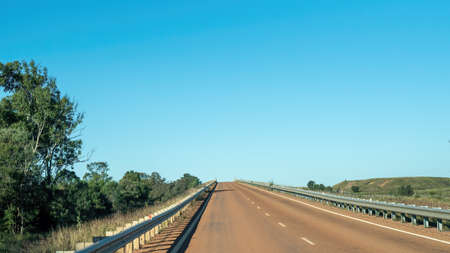 A sealed highway in the Australian outback traveling with no other vehicles in sight