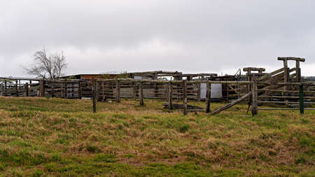 Old empty cattle yards on a country property on a dull and overcast day Stock Photo