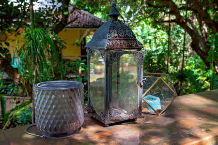 Old uncared for vintage objects on display in the sunlight in a rustic country bushland garden