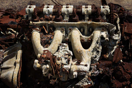 The rusted remains of a burnt out car left abandoned on tidal salt flats Stock Photo