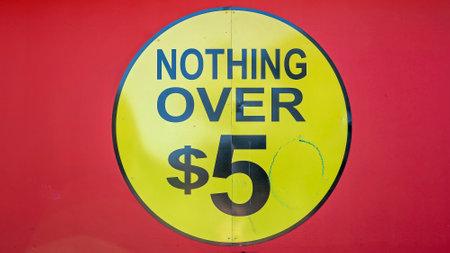 Mackay, Queensland, Australia - January 2021: Nothing Over $5 advertisement sign