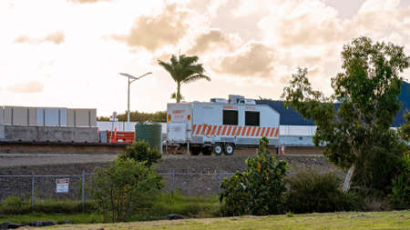 Mackay, Queensland, Australia - January 2021: A van hired as a mobile office for a construction company building a highway overpass