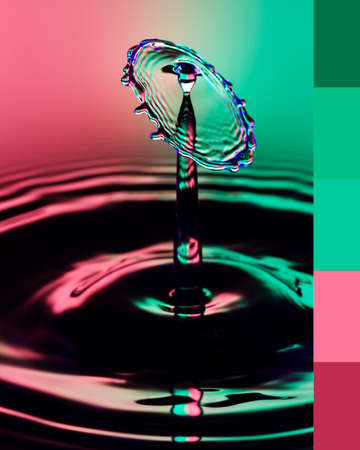 Green and pink tones hues color palette inspired by liquid drop art. Macro close up of a water drop with color theme.