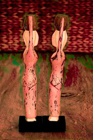Wooden ornamental female dolls on black stands Reklamní fotografie