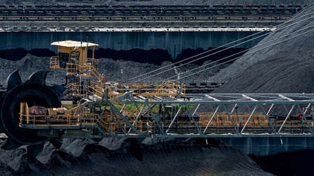Mackay, Queensland, Australia - March 2021: Giant machinery amongst coal stockpiles at export terminal