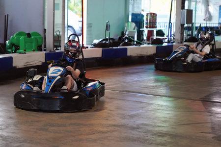Mackay, Queensland, Australia - April 2021: A man drives a go-kart in a fun recreational drive around a circuit in public Редакционное