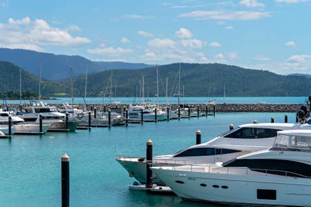 Airlie Beach, Queensland, Australia - April 2021: Close up of luxury yachts at Coral Sea Marina