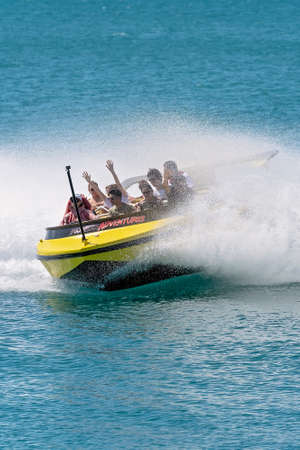 Airlie Beach, Queensland, Australia - April 2021: Passengers having fun in a jet boat adrenaline ride on the ocean at Whitsundays