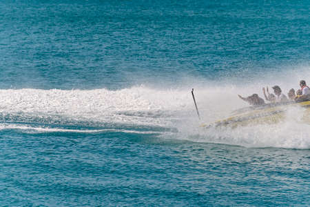 Airlie Beach, Queensland, Australia - April 2021: Water spray engulfs a jet boat as it spins as part of an adrenalin ride