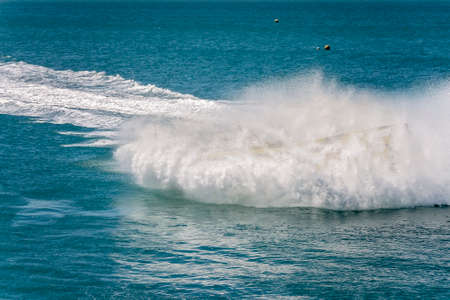 Passengers having fun in a jet boat as it turns into a spin and drenches them with sea water on an adrenaline ride on the ocean at Whitsundays