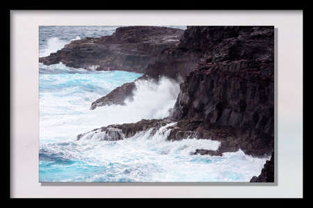 Blowholes marine erosion on the rocky Australian coastline near Portland in Victoria, in a photo frame