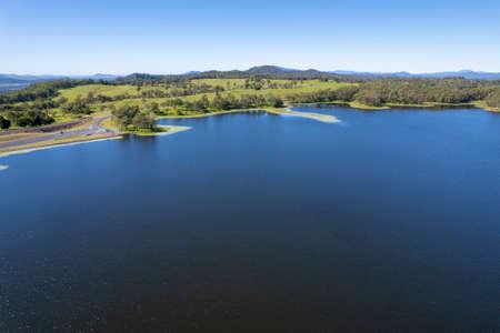 Aerial towards shore over water catchment area Teemburra Dam Queensland Australia