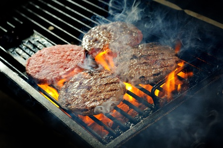 Beef burgers being cooked