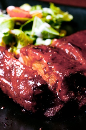 closeup of ribs with salad