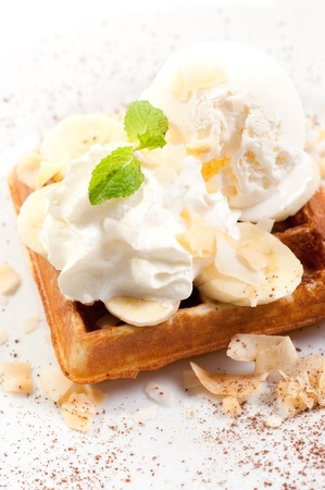Waffles with ice cream with banana split