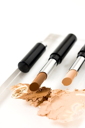 contouring cream stick, beauty treatment on face photo