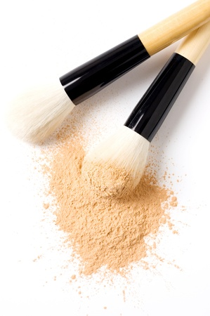 closeup of face powder and brush isolated photo