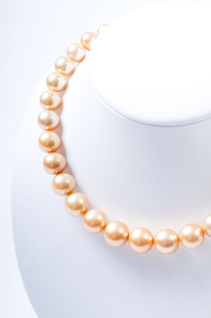 closeup of gold color Pearl necklace Stock Photo