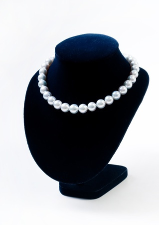 Pearl necklace on black model photo