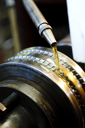 lubricant: Moving oil in a machine, Factory operator